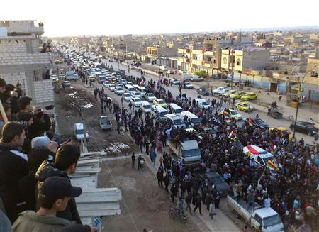 Anti Syrian president Bashar al-Assad mourners surround the hearse carrying the coffin of Kurdish opposition Naser Aldin Berhak during his funeral in Qamishli city February 22, 2012.   REUTERS/Handout
