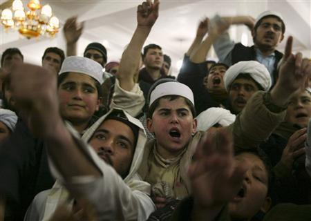 Afghan protesters shout anti-U.S. slogans during a protest at a mosque in the city of Herat February 23, 2012.  REUTERS/Mohammad Shoib