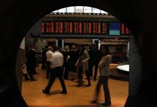 Visitors look at the stock price monitors at the BM&FBOVESPA Stock Market in Sao Paulo August 10, 2011. REUTERS/Paulo Whitaker