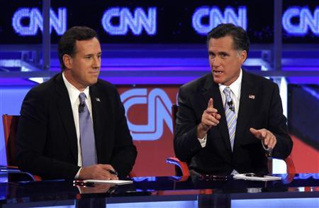 Republican presidential candidate former Senator Rick Santorum listens as former Massachusetts Governor Mitt Romney (R) speaks during the Republican presidential candidates debate in Mesa, Arizona, February 22, 2012.  REUTERS/Joshua Lott (