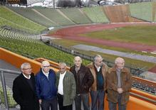 Former athletes Dan Alon, Shaul Paul Ladany, Gad Tsabary, Avraham Melamed, Henry Hershkovitz and Zelig Shtorch (L-R) of the Israeli Olympic team of 1972 are pictured in Munich's Olympic stadium February 23, 2012.