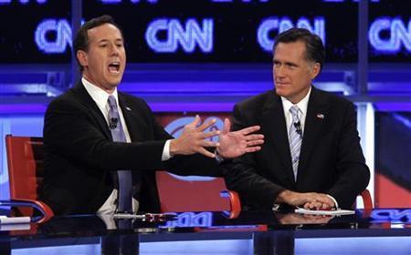 U.S. Republican presidential candidate former U.S. Senator Rick Santorum speaks as former Massachusetts Governor Mitt Romney (R) looks on during the Republican presidential candidates debate in Mesa, Arizona, February 22, 2012. REUTERS/Joshua Lott