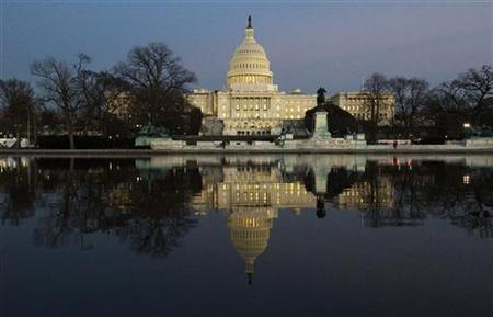 Dusk sets in over the U.S. Capitol building hours before U.S. President Barack Obama is set to deliver his State of the Union address to a joint session of Congress on Capitol Hill in Washington, January 24, 2012.  REUTERS/Jonathan Ernst