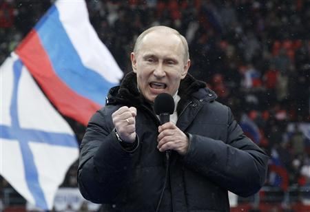 Presidential candidate and Russia's current Prime Minister Vladimir Putin delivers a speech during a rally to support his candidature in the upcoming presidential election at the Luzhniki stadium on the Defender of the Fatherland Day in Moscow February 23, 2012. Russia will go to the polls for a presidential election on March 4.  REUTERS/Sergei Karpukhin