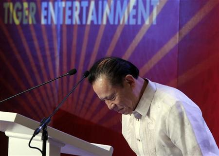 Kazuo Okada, chairman of Universal Entertainment Corp, bows after speaking at the ground-breaking ceremony of its casino-hotel projects in Manila January 26, 2012.               REUTERS/Romeo Ranoco
