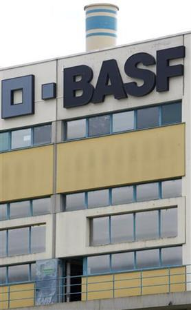 A logo is seen on the facade of the BASF plant and former Ciba production site in Schweizerhalle near Basel July 7, 2009. BASF plans to cut 3,700 jobs as part of the integration of Swiss rival Ciba and may sell or close as many as 23 of Ciba's 55 sites, it said on Monday. REUTERS/Christian Hartmann  (SWITZERLAND BUSINESS SCI TECH EMPLOYMENT)