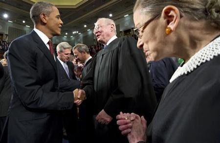 U.S. President Barack Obama greets greets U.S. Supreme Court Justices Anthony Kennedy (C) and Ruth Bader Ginsburg (R) prior to the president's State of the Union address to a joint session of Congress on Capitol Hill in Washington, January 24, 2012. REUTERS/Saul Loeb/Pool