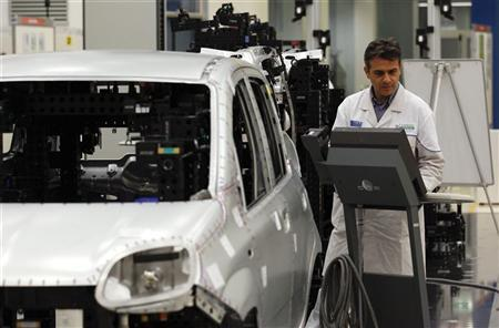 An employee of Fiat performs a quality control check on the new Panda car at the Fiat plant in Pomigliano D'Arco, near Naples, December 14, 2011. REUTERS/Alessandro Bianchi
