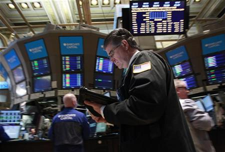 Traders work on the floor of the New York Stock Exchange February 21, 2012. REUTERS/Brendan McDermid