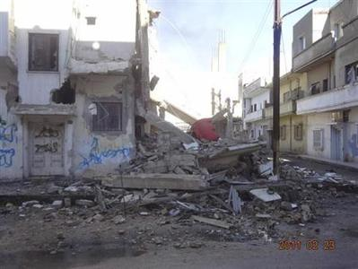 Debris and damaged houses are seen after government forces shelled the opposition-held area of Bab Amro, in Homs, in this handout picture received February 23, 2012. REUTERS/Handout