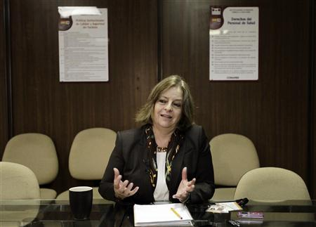 National Institute of Psychiatry's Director Maria Elena Medina speaks about the patent of a new vaccine that could reduce addiction to heroin, during a news conference at the institute in Mexico City February 23, 2012. Researchers at the institute say they have successfully tested the vaccine on mice and are preparing to test it on humans. The vaccine, which has been patented in the United States, works by making the body resistant to the effects of heroin, so users would no longer get a rush of pleasure when they smoke or inject it. REUTERS/Henry Romero