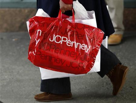 A pedestrian walks with a shopping bag from a JC Penney department store in New York March 2, 2010.  REUTERS/Natalie Behring