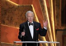 "Actor Christopher Plummer accepts the award for outstanding performance by a male actor in a supporting role for ""Beginners"", at the 18th annual Screen Actors Guild Awards in Los Angeles, California January 29, 2012. REUTERS/Lucy Nicholson"