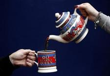 Tea is poured into a mug using a tea pot from the Diamond Jubilee Collection at the Emma Bridgewater pottery factory in Stoke-On-Trent, February 24, 2012.  REUTERS/Phil Noble