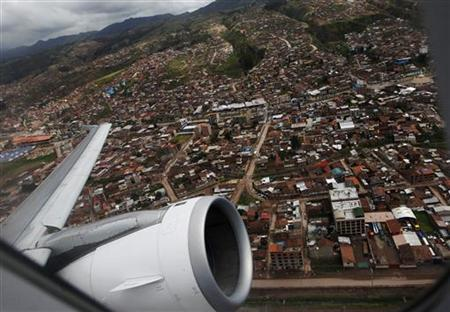 A LAN Airlines plane take off from Cuzco to Lima, in the first Latin American flight using the Required Navigation Performance system February 23, 2012. REUTERS/Mariana Bazo