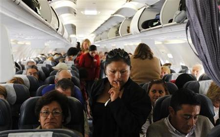 LAN Airlines passengers prepare to take off from Cuzco to Lima, in the first Latin American flight using the Required Navigation Performance system, February 23, 2012. REUTERS/Mariana Bazo