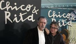 "Oscar-winning Spanish film director Fernando Trueba (L) and Spain's most famous and successful designer Javier Mariscal pose during a photocall to promote their animated feature-length film ""Chico & Rita"" in Madrid February 21, 2011. REUTERS/Sergio Perez"