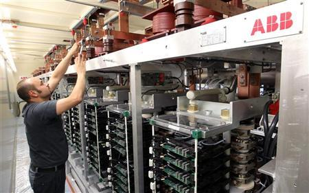A technician prepares a power converter at a plant of Swiss engineering group ABB in the town of Turgi west of Zurich June 9, 2010.     REUTERS/Arnd Wiegmann