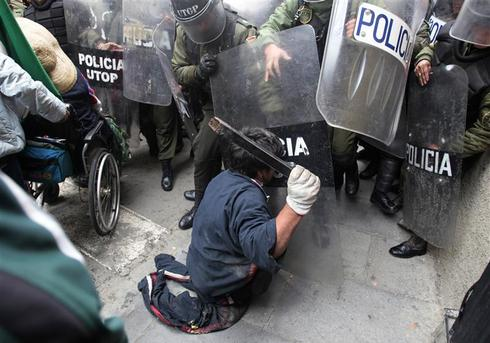Disabled persons clash with riot police