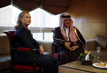Secretary of State Hillary Clinton (L) meets Saudi Arabia's Foreign Minister Prince Saud al-Faisal at the Friends of Syria Conference in Tunis, February 24, 2012.    REUTERS/Jason Reed