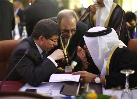 Turkey's Foreign Minister Ahmet Davutoglu (L) confers with United Arab Emirates' (UAE) Foreign Minister Sheikh Abdullah bin Zayed al-Nahyan during the Friends of Syria Conference in Tunis, February 24, 2012.  REUTERS/Jason Reed