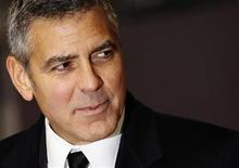 Actor George Clooney arrives for the British Academy of Film and Arts (BAFTA) awards ceremony at the Royal Opera House in London   February 12, 2012.    REUTERS/Luke MacGregor