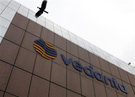 A bird flies by the Vedanta office building in Mumbai August 16, 2010. REUTERS/Danish Siddiqui/Files