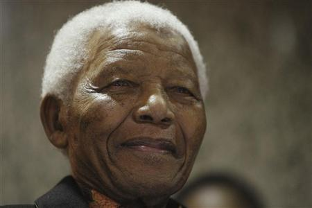 Former South African President Nelson Mandela listens to the State of The Nation address being delivered by the current  President Jacob Zuma at Parliament in Cape Town June 3, 2009.    REUTERS/Mike Hutchings