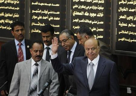 Yemen's newly elected Abd-Rabbu Mansour Hadi waves as he arrives to take the oath in parliament in Sanaa February 25, 2012. REUTERS/Khaled Abdullah