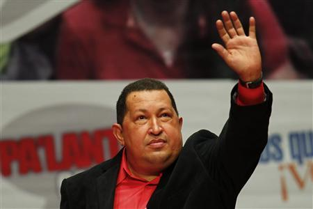 Venezuela's President Hugo Chavez waves during a rally with supporters prior to his trip to Cuba in Caracas February 23, 2012.  REUTERS/Jorge Silva