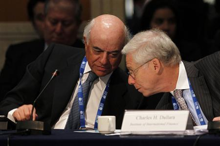Francisco Gonzalez (L), chairman and CEO of BBVA, speaks with Charles Dallara, managing director of the Institute of International Finance, during a meeting of finance ministers and central bankers from the Group of 20 top economies in Mexico City February 25, 2012. REUTERS/Edgard Garrido