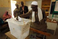 A Senegalese man votes during Senegal's presidential election in the capital Dakar, February 26, 2012. REUTERS/Youssef Boudlal