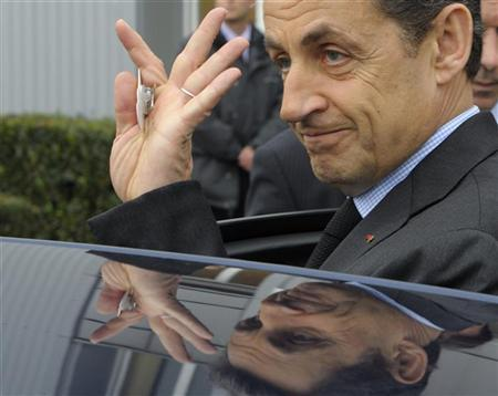 France's President Nicolas Sarkozy enters his car as he leaves the Petroplus oil refinery  in Petit-Couronne, near Rouen, northwestern France, February 24, 2012.  REUTERS/Philippe Wojazer
