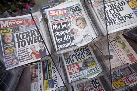 Copies of the Sun on Sunday are displayed for sale, on the first day of publication, in a  newsagents in Wembley, north London February 26, 2012. REUTERS/Andrew Winning