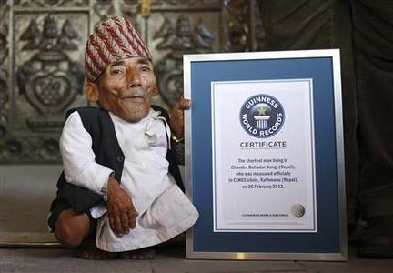 Chandra Bahadur Dangi, 72, poses for a picture with his certificate after being announced as the world's shortest man living, as well as shortest person ever measured by the Guinness World Records, in Kathmandu February 26, 2012. REUTERS/Navesh Chitrakar