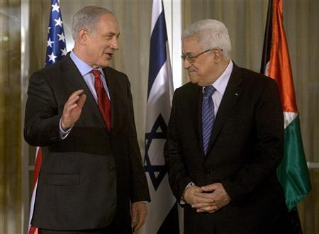 Israel's Prime Minister Benjamin Netanyahu (L) stands with Palestinian President Mahmoud Abbas before their meeting in Jerusalem, September 15, 2010. REUTERS/Lior Mizrahi/Pool