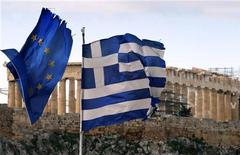 The Parthenon on the Athens Acropolis is seen behind a Greek and an EU flag atop the Greek ministry of finance February 8, 2012. REUTERS/Yannis Behrakis