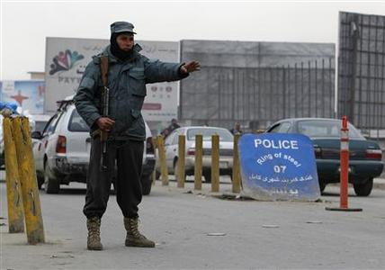 An Afghan policeman keeps watch at a check point in Kabul February 26, 2012.   REUTERS/Omar Sobhani