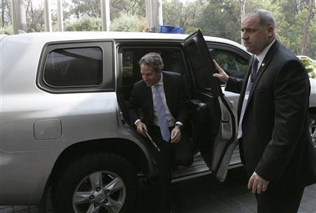 U.S. Treasury Secretary Timothy Geithner (C) arrives at a meeting of Group of 20 finance ministers and central bankers in Mexico City February 25, 2012. REUTERS/Bernardo Montoya