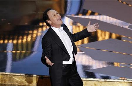 Oscar host Billy Crystal sings at the beginning of the 84th Academy Awards in Hollywood, California, February 26, 2012. REUTERS/Gary Hershorn