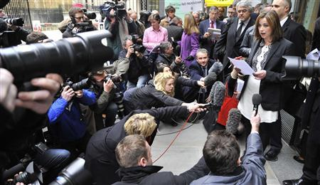 British singer Charlotte Church reads a statement outside of the High Court in London, February 27, 2012. REUTERS/Toby Melville