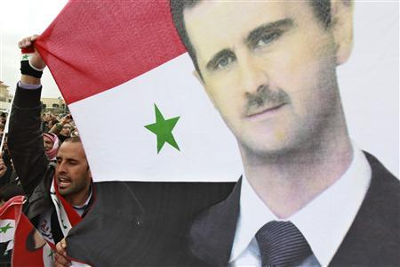 Syrian supporters of President Bashar al-Assad living in Jordan celebrate during a referendum on a new constitution in front of the Syrian embassy in Amman February 26, 2012. REUTERS/ Muhammad Hamed