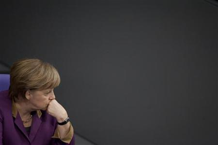 German Chancellor Angela Merkel attends a debate before a parliamentary vote on a Greek bailout package in the Bundestag, the lower house of parliament, in Berlin , February 27, 2012.  Germany's parliament was almost certain to endorse a second Greek bailout on Monday but Chancellor Angela Merkel was torn between domestic pressure to stop throwing good money after bad and global calls to boost Europe's crisis defences.   REUTERS/Thomas Peter (GERMANY - Tags: POLITICS BUSINESS)