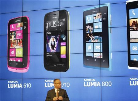 Nokia's President and CEO Stephen Elop attends a news conference during the Mobile World Congress in Barcelona February 27, 2012. Nokia has unveiled a new, cheaper smartphone using Microsoft's Windows Phone software, targeting a wider market for its new range of smartphones. The GSMA Mobile World Congress, representing the interests of the worldwide mobile communications industry, will take place from February 27 to March 1 in Barcelona. REUTERS/Gustau Nacarino