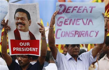 Supporters of Sri Lanka's President Mahinda Rajapaksa hold up images of him during a protest against the United Nations, in Colombo February 27, 2012. REUTERS/Dinuka Liyanawatte