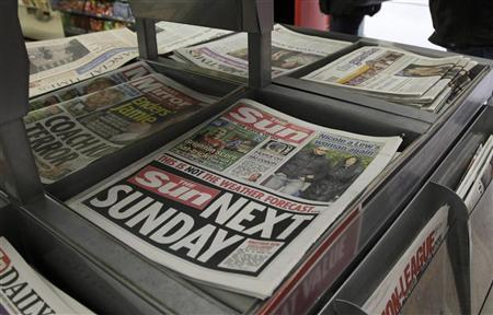 Copies of The Sun newspaper are seen for sale at a newsstand in London February 20, 2012. REUTERS/Stefan Wermuth