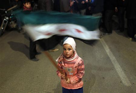 A girl waves a Syrian opposition flag during a protest against Syrian President Bashar al Assad in Al Qusayr, Syria, February 27, 2012.  REUTERS/Goran Tomasevic