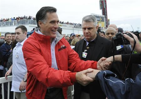 Republican presidential candidate and former Massachusetts Gov. Mitt Romney (front, L) greets race fans during his appearance at the NASCAR Sprint Cup Series 54th Daytona 500 race at the Daytona International Speedway in Daytona Beach, Florida, February 26, 2012.      REUTERS/Brian Blanco