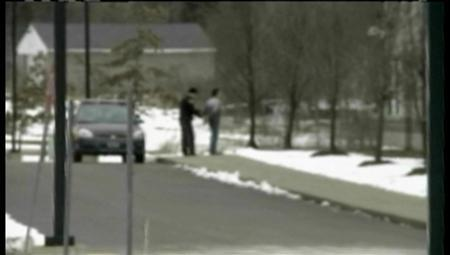 A police officer arrests a suspect in Chardon, Ohio, in this still photograph taken from video received on February 27, 2012. REUTERS/WKYC Cleveland