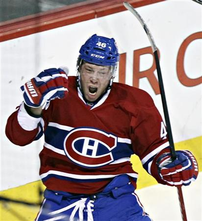 Montreal Canadiens' Andrei Kostitsyn celebrates his goal over New York Islanders' goalie Al Montoya (not shown) during first period NHL action in Montreal, December 13, 2011.  REUTERS/Christinne Muschi